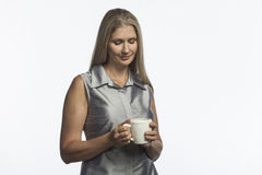 Woman holding mug with hot beverage, horizontal Stock Photo