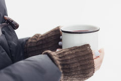 Woman holding mug of mulled wine in her hands outdoors Royalty Free Stock Photo