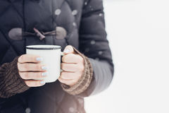Woman holding mug of mulled wine in her hands outdoors Stock Photography