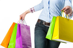 Woman holding multicolored shopping paper bags Royalty Free Stock Photo