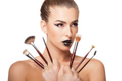 Woman holding multiple make up brushes in hands Royalty Free Stock Photo