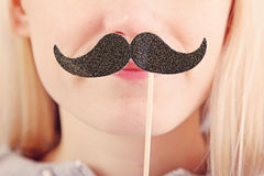 Woman holding mustache on a stick Stock Photo