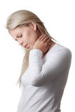 Woman holding the neck isolated on white background. Royalty Free Stock Photo