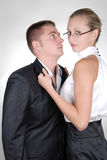 A woman holding neckband of a man with passion Royalty Free Stock Photography