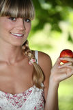 Woman holding a nectarine Stock Photography