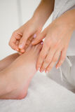 Woman holding a needle in an acupuncture therapy Stock Photos