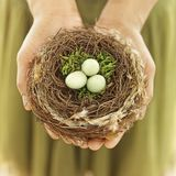 Woman holding nest egg Stock Photos