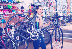 Woman holding new bicycle Stock Photography