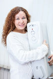 Woman holding new buying radiator in hands Royalty Free Stock Image