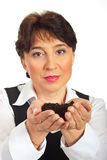 Woman holding new plant life Stock Image
