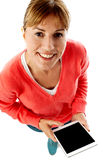 Woman holding new tablet pc, aerial view Royalty Free Stock Photos