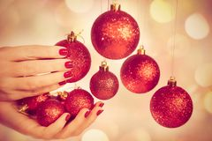 Woman holding New Year round balls ready to decorate tree stock photography