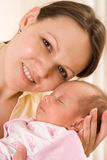 Woman holding  a newborn Royalty Free Stock Photography