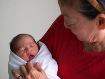 Woman holding newborn child Stock Image