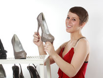 Woman holding a nice shoe stock images