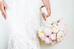 Woman Holding a nice Wedding Bouquet Stock Images
