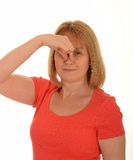 Woman holding nose Royalty Free Stock Photo