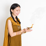 Woman holding oil lamp Royalty Free Stock Photo