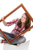 Woman holding an old picture frame over Stock Photos