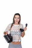Woman holding old telephone Stock Photography