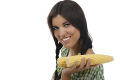 Woman holding one corn cob. Isolated on white royalty free stock photography