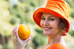 Woman  holding one   orange Royalty Free Stock Photography