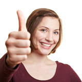 Woman holding one thumb up Stock Photo