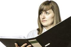 Woman holding open file folder Stock Photo