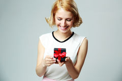 Woman holding an open jewelery gift box Stock Photos