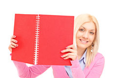 Woman holding an opened notebook Royalty Free Stock Image