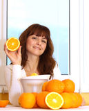 Woman Holding Orange Stock Photo