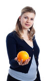 Woman holding orange Royalty Free Stock Images