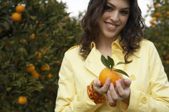 Woman Holding Orange Royalty Free Stock Image