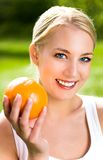 Woman holding an orange Stock Photo