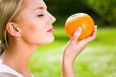 Woman holding an orange Royalty Free Stock Image