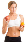 Woman Holding An Orange And An Apple Royalty Free Stock Images