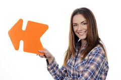 Woman holding orange arrow Stock Photos