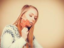 Woman holding orange autumn leaf Stock Photos