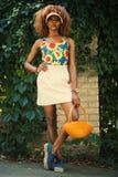 Woman Holding Orange Basket Royalty Free Stock Images