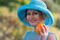 Woman holding  orange Royalty Free Stock Images