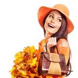 Woman holding orange handbag. Woman holding orange leaf and handbag. Autumn fashion stock photography