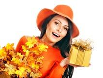 Woman holding  orange handbag. Stock Photo
