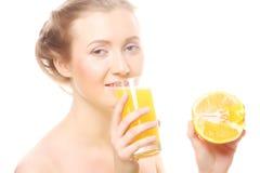Woman holding orange juice Royalty Free Stock Images
