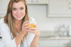 Woman holding an orange juice Royalty Free Stock Photo