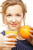 Woman holding orange and  juice over white Stock Image