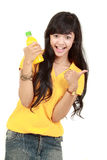 Woman holding orange juice smiling Stock Photography