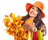 Woman holding  orange leaves. Stock Images