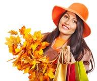 Woman holding  orange leaves. Stock Images