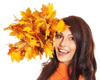 Woman holding orange leaves. Isolated royalty free stock photography