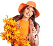 Woman holding orange leaves. Woman wearing overcoat holding orange leaves royalty free stock images